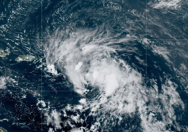 Satellite image released by the National Oceanic and Atmospheric Administration (NOAA) shows Tropical Storm Laura in the North Atlantic Ocean, Friday, Aug. 21, 2020.