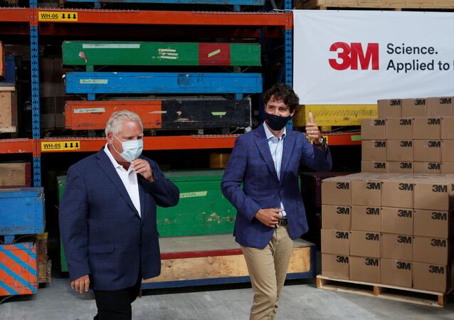 Canada's Prime Minister Justin Trudeau and Ontario Premier Doug Ford at the 3M's plant in Brockville, Ontario