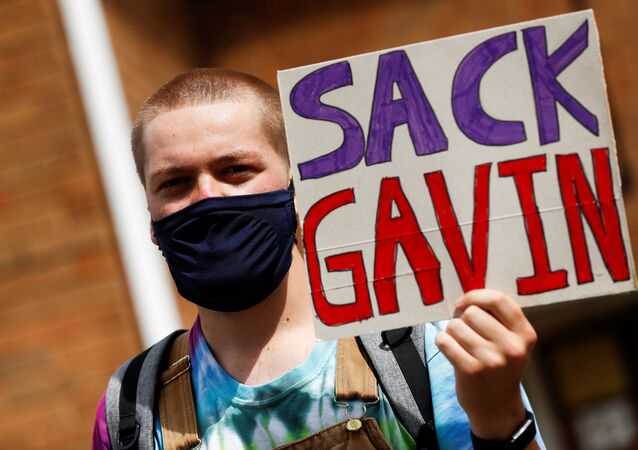 A-level student holds a placard during a protest about the exam results at the constituency offices of Education Secretary Gavin Williamson, amid the spread of the coronavirus disease (COVID-19), in South Staffordshire, Britain, August 17, 2020. REUTERS/Jason Cairnduff