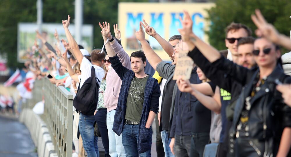 People attend an opposition demonstration to protest against presidential election results in Minsk, Belarus August 21, 2020.