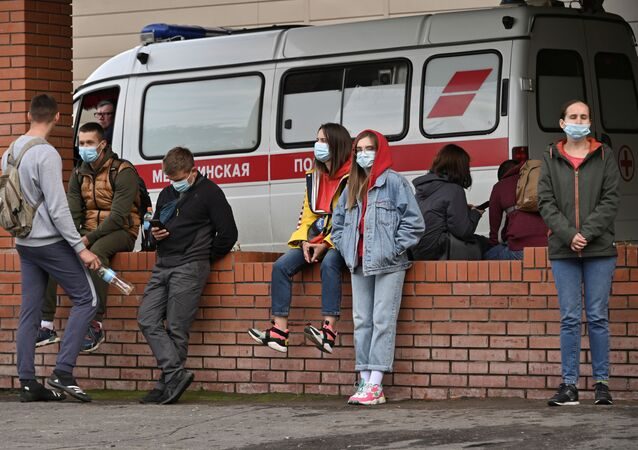 People gather outside a hospital, where Russian opposition politician Alexei Navalny receives medical treatment in Omsk, Russia August 21, 2020.