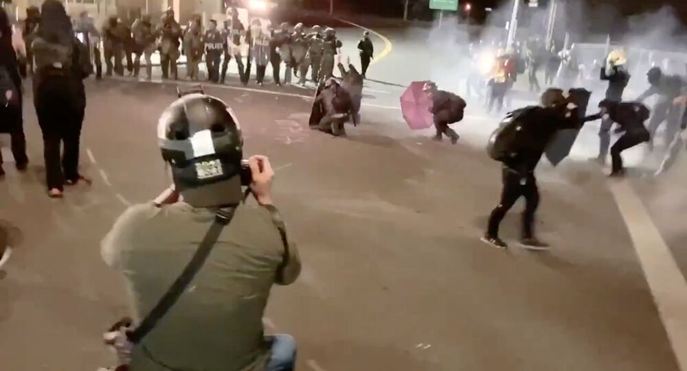 Protesters confront with the police near an Immigration and Customs Enforcement centre in Portland, Oregon, U.S., August 20, 2020, in this still image from a video obtained from social media.