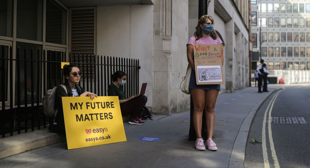 People take part in a protest over the governments handling of exam results, outside the Department for Education, amid the spread of the coronavirus disease (COVID-19), in London, Britain, August 22, 2020.