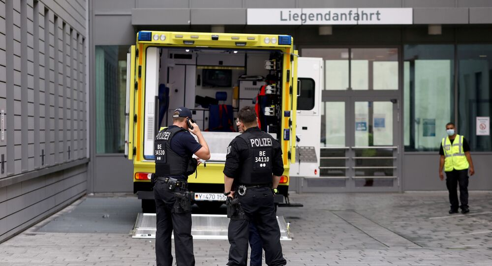 Police officers are seen in front of an ambulance that allegedly transported Russian opposition figure Alexei Navalny to Charite Mitte Hospital Complex where he will receive medical treatment in Berlin, Germany August 22, 2020.