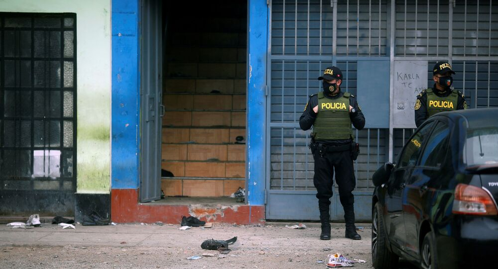 Police officers stand guard outside a nightclub after it was raided for hosting a party in violation of the coronavirus disease (COVID-19) restrictions, in Lima, Peru, August 23, 2020.