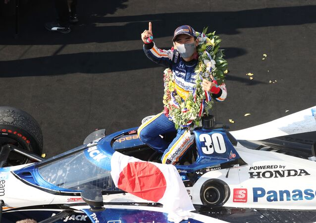 Aug 23, 2020; Indianapolis, Indiana, USA; IndyCar driver Takuma Sato (30) reacts in victory lane after winning the 104th running of the Indianapolis 500 at the Indianapolis Motor Speedway.