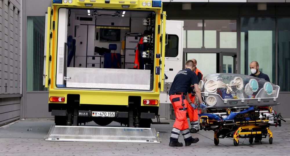 Paramedics load a stretcher into an ambulance that allegedly transported Russian opposition leader Alexei Navalny at Charite Mitte Hospital Complex where he will receive medical treatment in Berlin, Germany August 22, 2020.