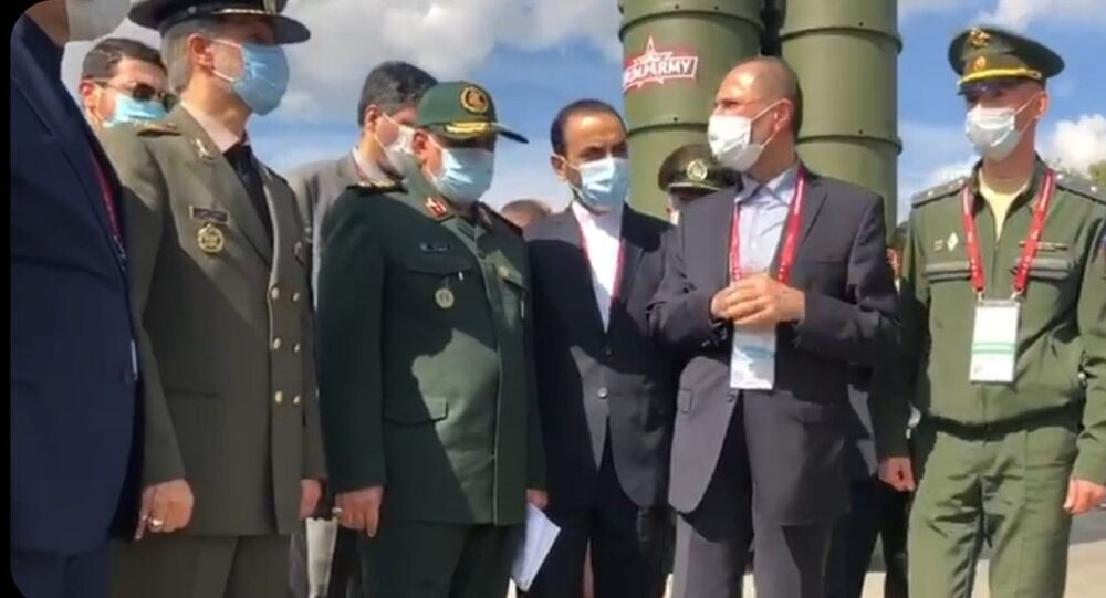 Iranian Defence Minister Amir Hatami, second from left, speaks to Russian officials at the ARMY-2020 military expo outside Moscow, 23 August 2020.