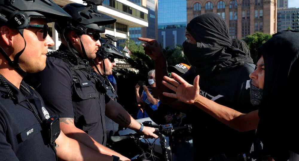 Demonstrators against racial injustice yell at police near the site of the Democratic National Convention (DNC), which is mostly virtual, due to the coronavirus disease (COVID-19) outbreak, in Milwaukee, Wisconsin, 20 August 2020