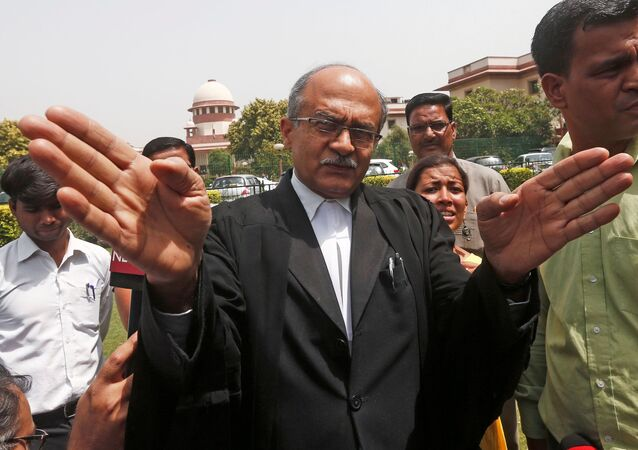 FILE PHOTO: Prashant Bhushan, a senior lawyer representing the petitioner, speaks with the media after India's Supreme Court dismissed petitions calling for an investigation into the death of Judge B. Loya, a lower court judge, outside the Supreme Court in New Delhi, India April 19, 2018
