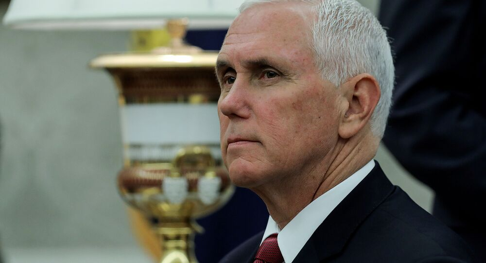 U.S. Vice President Mike Pence LISTENS during U.S. President Donald Trump's meeting with Iraq's Prime Minister Mustafa al-Kadhimi in the Oval Office at the White House in Washington, U.S., August 20, 2020