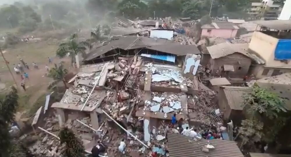 More than 70 people were feared trapped after a five-storey building, housing 40 apartments, collapsed in India's Maharashtra state on Monday evening.