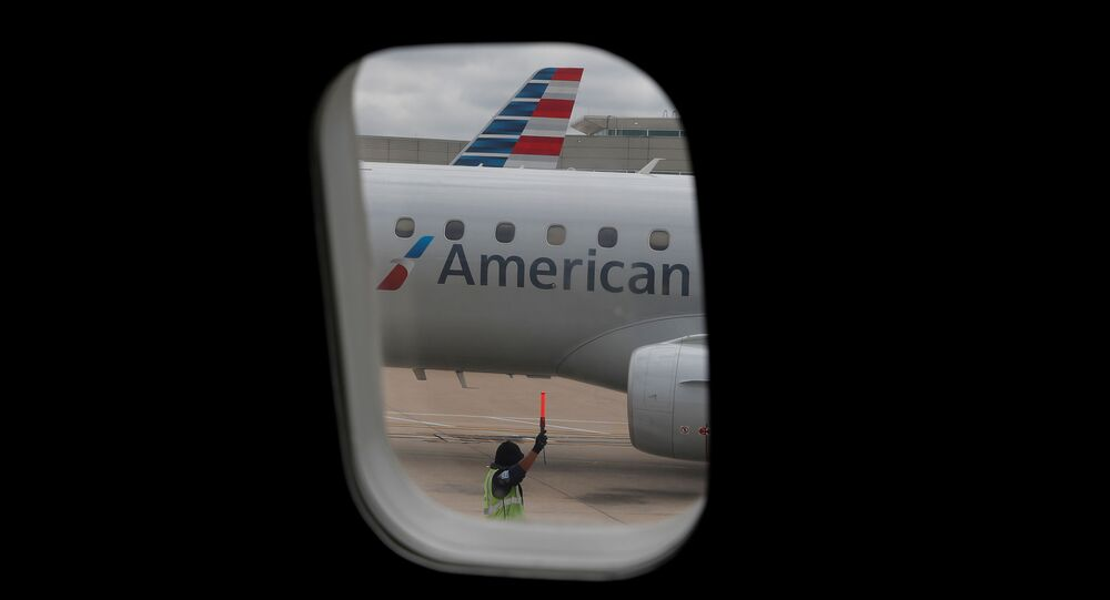 FILE PHOTO: An airlines worker signals next to an American Airlines plane that arrived at Hartsfield–Jackson Atlanta International Airport, as the coronavirus disease (COVID-19) continues, in Atlanta, Georgia, U.S., May 19, 2020. REUTERS/Shannon Stapleton/File Photo