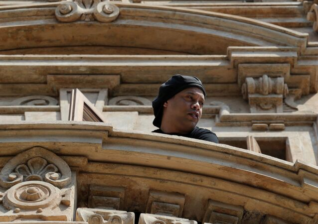 Ronaldinho is seen on a balcony of the Paraguayan hotel where he has been under house arrest for four months in Asuncion, Paraguay, August 24, 2020