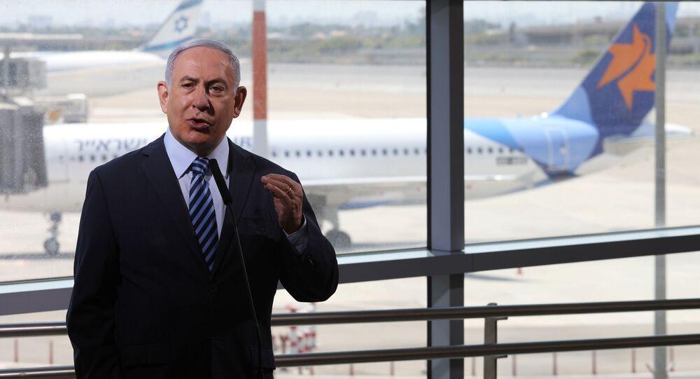 Israeli Prime Minister Benjamin Netanyahu gestures as he gives a statement at Ben Gurion International Airport, in Lod, near Tel Aviv, Israel August 17, 2020.