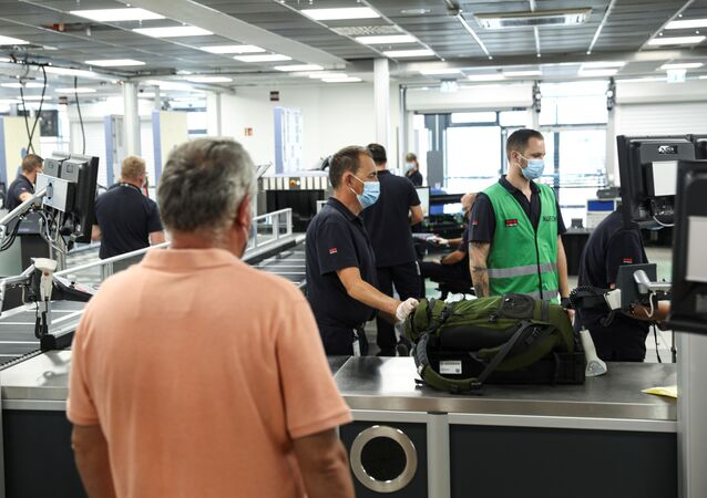 A security check is pictured in the former Berlin Schoenefeld airport that has been integrated as Terminal T5 into the newly built Berlin Brandenburg Airport Willy Brandt (BER) ahead of the opening of the airport in October in Schoenefeld, Germany, August 24, 2020