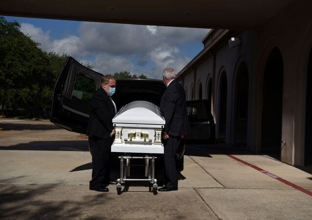 Michael Doyle, 49, a funeral director at Beresford Funeral Service, and Bill Jones, 71, a hearse driver, prepare the casket before family and friends arrive for the funeral of Lebanon-born Rita Basbous, 53,  at Our Lady of the Cedars Maronite Catholic Church in Houston, Texas, U.S., August 12, 2020.