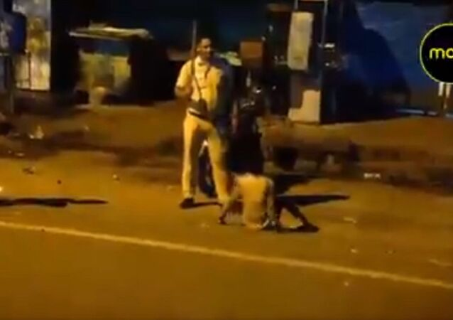 A policeman seen assaulting a young boy, in a video that surfaced from RK Puram