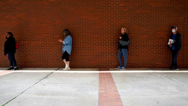 People who lost their jobs wait in line to file for unemployment benefits, following an outbreak of the coronavirus disease (COVID-19), at Arkansas Workforce Center in Fort Smith, Arkansas, U.S. April 6, 2020 - Sputnik International