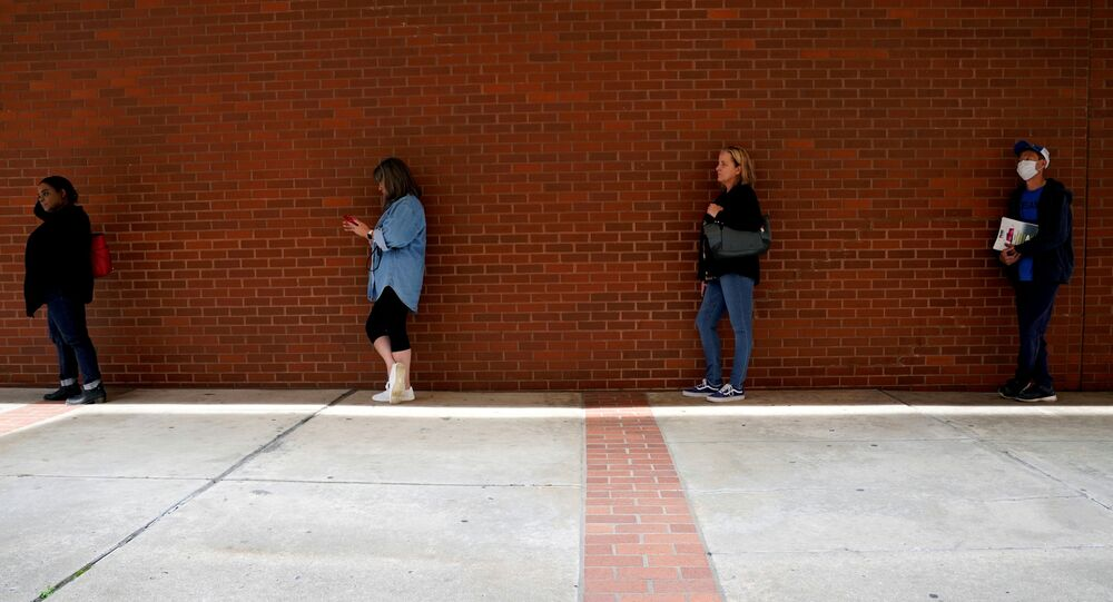 People who lost their jobs wait in line to file for unemployment benefits, following an outbreak of the coronavirus disease (COVID-19), at Arkansas Workforce Center in Fort Smith, Arkansas, U.S. April 6, 2020