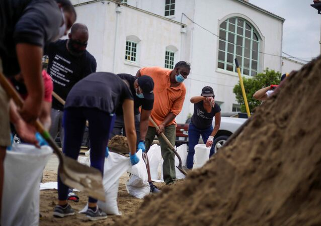 Residents fill sandbags at St. Raymond Church, provided by Mayor LaToya Cantrell and the local government, as Hurricane Laura warnings have been issued for part of Louisiana and Texas, in New Orleans, Louisiana, U.S., August 25, 2020.