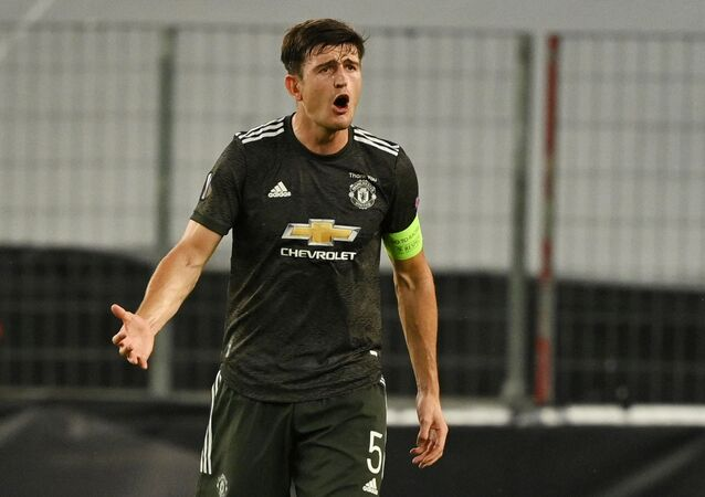 Soccer Football - Europa League Semi Final - Sevilla v Manchester United - RheinEnergieSTADION, Cologne, Germany - August 16, 2020  Manchester United's Harry Maguire reacts, as play resumes behind closed doors following the outbreak of the coronavirus disease (COVID-19)