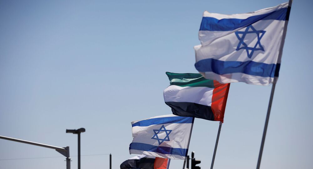 The national flags of Israel and the United Arab Emirates flutter along a highway following the agreement to formalize ties between the two countries, in Netanya, Israel August 17, 2020.