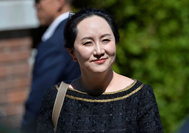 Huawei Technologies Chief Financial Officer Meng Wanzhou smiles as she leaves her home to attend a court hearing in Vancouver, British Columbia, Canada May 27, 2020.