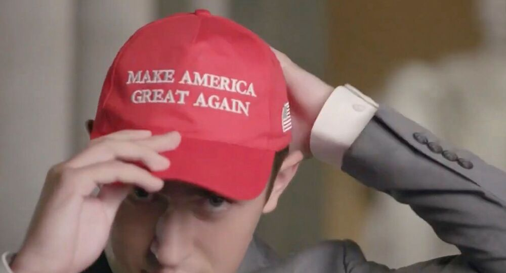 Former Covington Catholic High School Student Nicholas Sandmann puts on a Make America Great Again hat while he speaks by video feed as the Lincoln Memorial is seen in the background during the largely virtual 2020 Republican National Convention broadcast from Washington, U.S. August 25, 2020