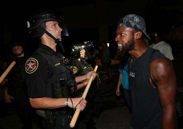 A man confronts police outside the Kenosha Police Department in Kenosha, Wisconsin, U.S., during protests following the police shooting of Black man Jacob Blake, August 23, 2020
