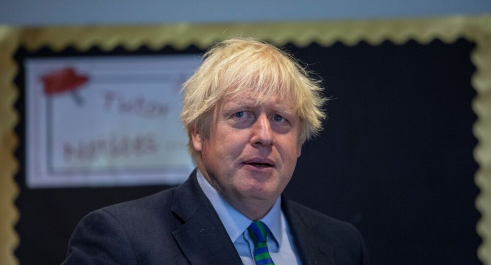 Britain's Prime Minister Boris Johnson visits Castle Rock school on the pupil's first day back to school, in Coalville, Britain August 26, 2020.