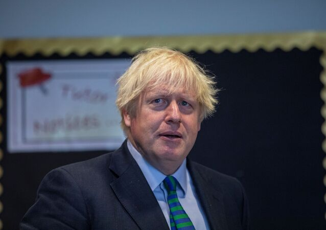 Britain's Prime Minister Boris Johnson visits Castle Rock school on the pupil's first day back to school, in Coalville, Britain 26 August 2020.