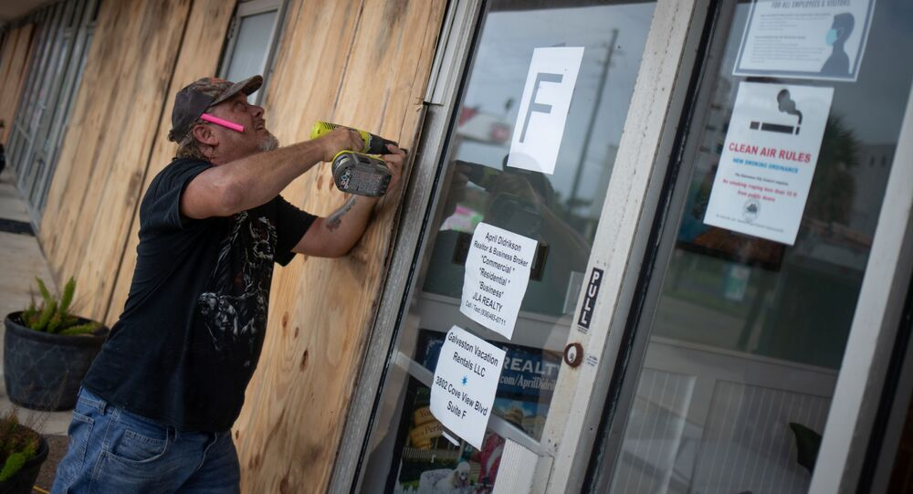 Local resident Robert Sawyer, 48, boards up businesses ahead of Hurricane Laura in Galveston, Texas, U.S., August 26, 2020.