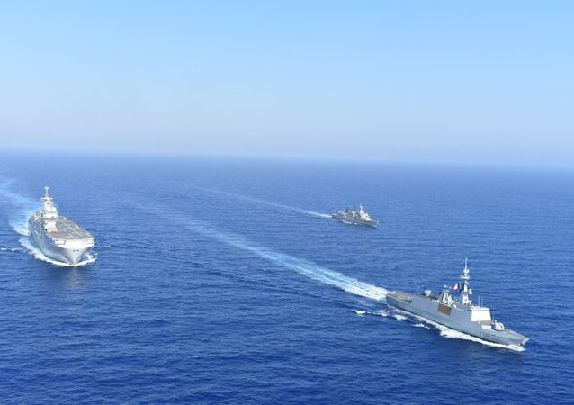 Greek and French vessels sail in formation during a joint military exercise in Mediterranean sea, in this undated handout image obtained by Reuters on August 13, 2020.