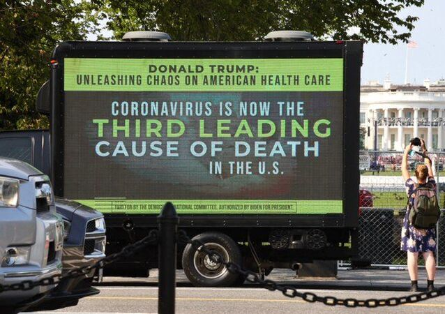 Photo of a Democratic National Committee billboard near the White House denouncing Donald Trump's COVID-19 response