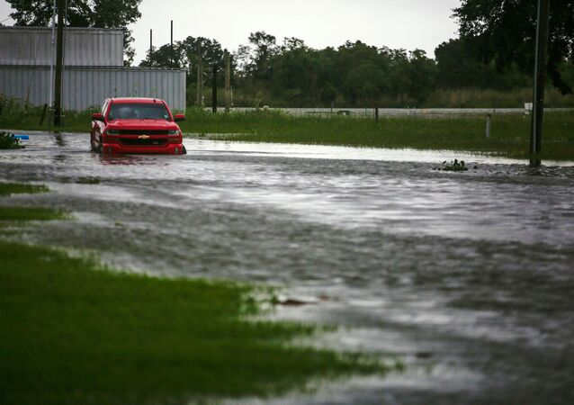 A car near Vermilion Bay is seen partially submerged in waters brought by Hurricane Laura approaching Abbeville, Louisiana, U.S., August 26, 2020