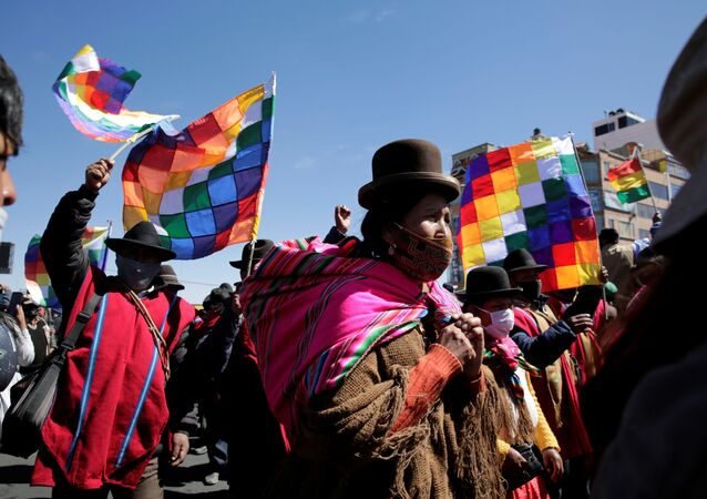 Aymara indigenous attend a rally demanding Bolivia's President Jeanine Anez's (not pictured) resignation, while the Bolivian Union Workers (COB) declare a pause to protests according to local media, amid the coronavirus disease (COVID-19), in El Alto, on the outskirts of La Paz, August 14, 2020