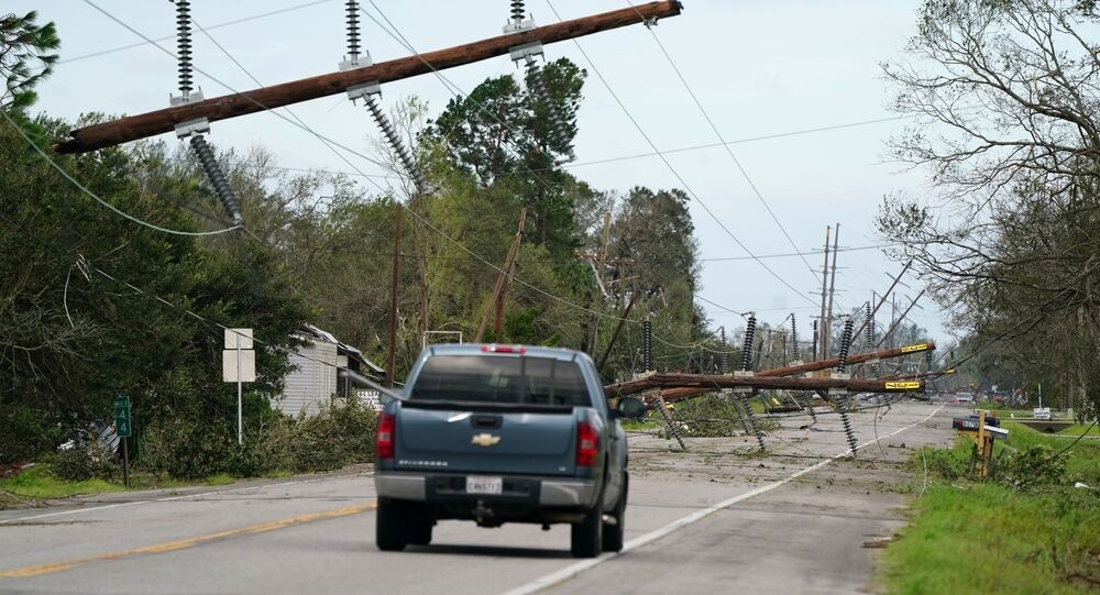 Downed power lines are seen on Highway 90 after Hurricane Laura passed through Iowa