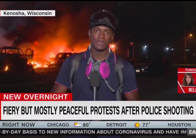 Screenshot of CNN live report from Kenosha protests, dubbed with the chyron FIERY BUT MOSTLY PEACEFUL PROTESTS AFTER POLICE SHOOTING