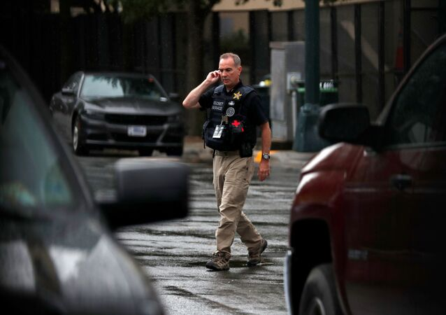A Secret Service officer walks near the entrance to the Republican National Convention, in Charlotte, North Carolina, U.S., August 24, 2020