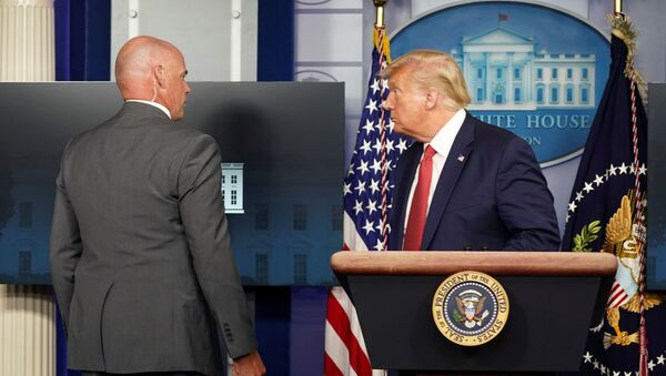 A Secret Service agent escorts U.S. President Donald Trump from a coronavirus disease (COVID-19) pandemic briefing after a shooting outside the White House in Washington, U.S., August 10, 2020. - Sputnik International