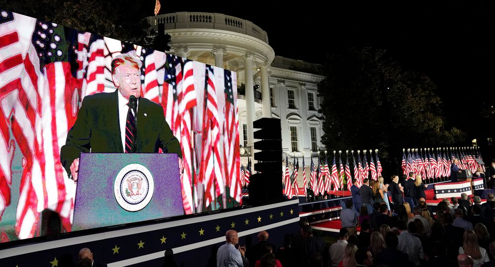 U.S. President Donald Trump is projected in a screen as he delivers his acceptance speech as the 2020 Republican presidential nominee during the final event of the Republican National Convention on the South Lawn of the White House in Washington, U.S., August 27, 2020.