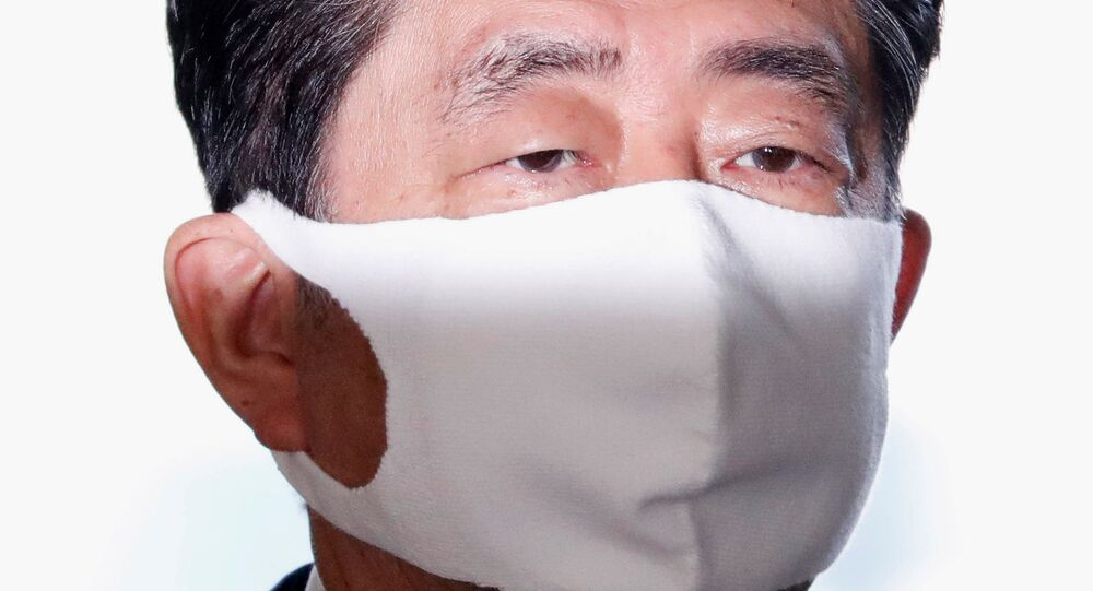 Japan's Prime Minister Shinzo Abe wearing a protective face mask arrives at his official residence, amid the coronavirus disease (COVID-19) outbreak, in Tokyo, Japan August 28, 2020