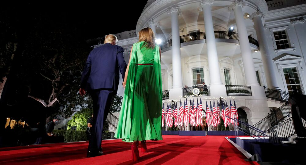 U.S. President Donald Trump walks back into the White House with first lady Melania Trump after delivering his acceptance speech as the 2020 Republican presidential nominee during the final event of the Republican National Convention on the South Lawn of the White House in Washington, U.S., August 27, 2020