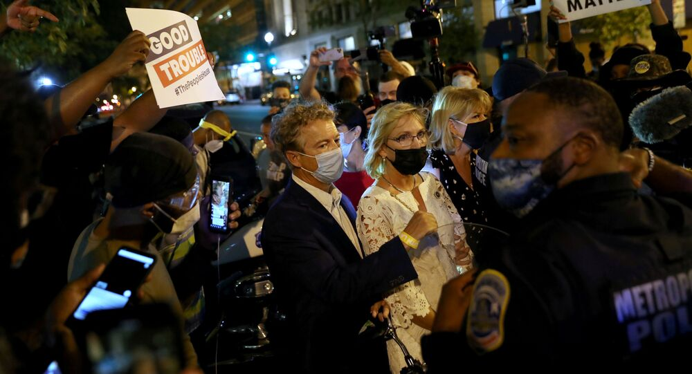 Protesters confront U.S. Senator Rand Paul (R-KY) during a protest in Washington, U.S. August 28, 2020