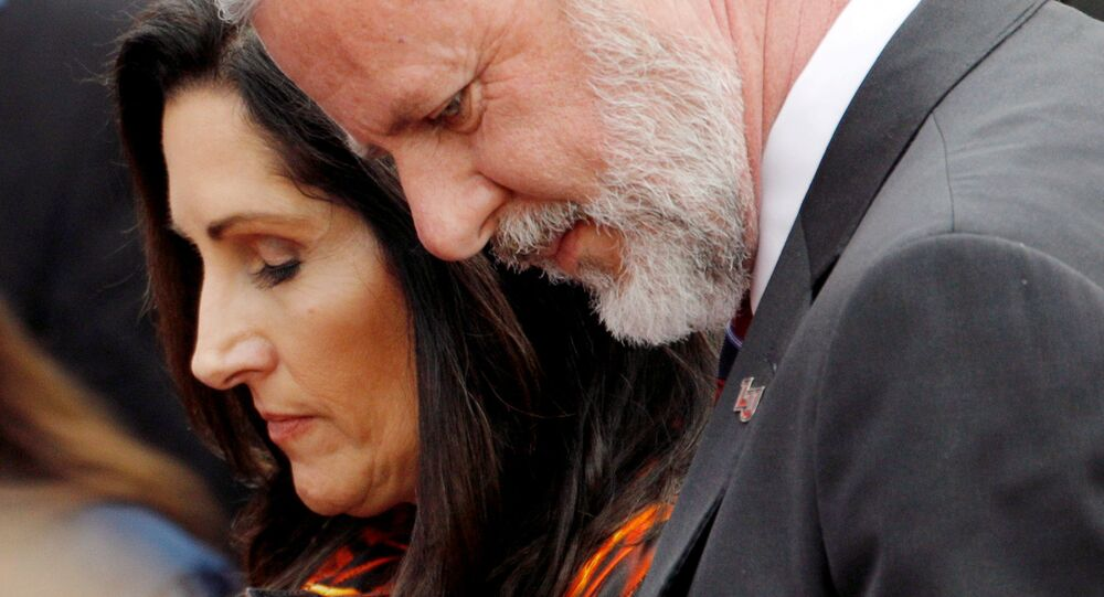 Liberty University President Jerry Falwell Jr. and his wife Becki Tilley bow their heads in a prayer after commencement ceremonies at Liberty University in Lynchburg, Virginia, U.S., May 11, 2019.