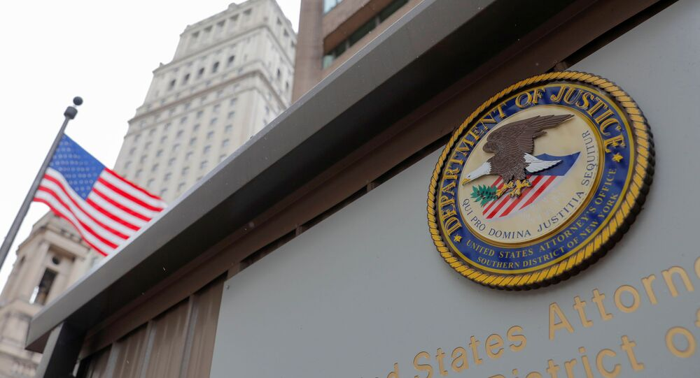 The seal of the United States Department of Justice is seen on the building exterior of the United States Attorney's Office of the Southern District of New York in Manhattan, New York City, U.S., August 17, 2020.