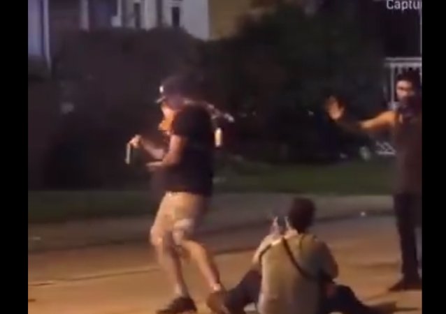 Screenshot from a video showing Kyle Rittenhouse shooting Gaige Grosskreutz, who has a gun in his hand, during protests in Kenosha, Wisconsin
