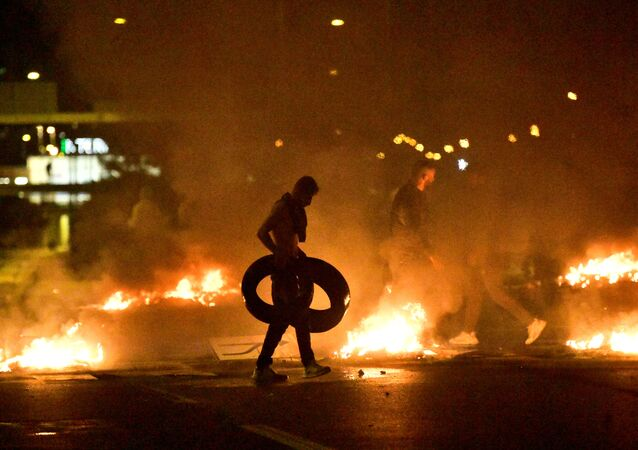 Demonstrators burn tyres during a riot in the Rosengard neighbourhood of Malmo, Sweden, 28 August 2020.