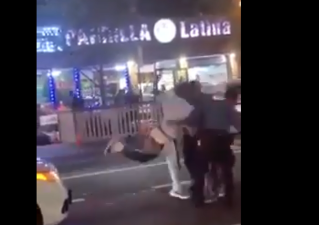 A screenshot from a video of a driver assaulting two New York Police Department traffic officers in the Bronx, New York, US, on 26 August 2020.
